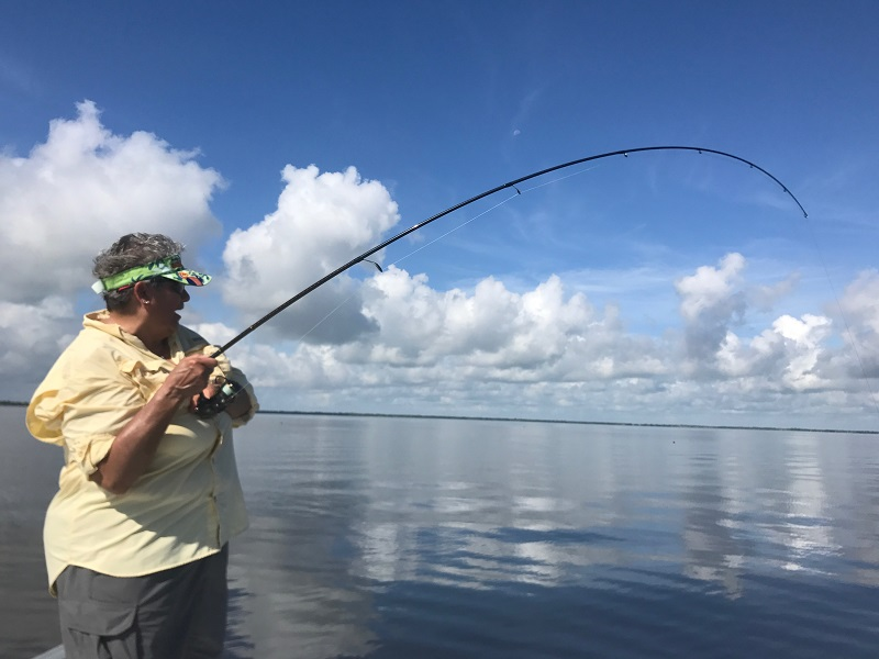 Man reels in a suspected drunk woman while fishing from a for Florida fishing regulations 2017