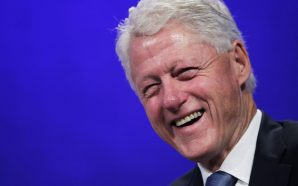 Bill Clinton helps to distribute supplies in Puerto Rico