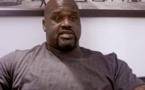 "Shaq in his DJ gig tells the crowd…""Put your middle…"