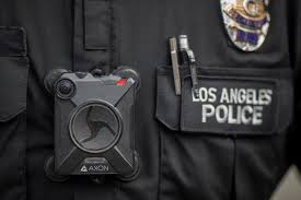 Body camera video shows moments before police shoot man holding…