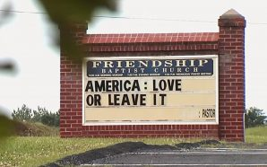 Pastor Defends 'America: Love or Leave It' Church Sign Amid…