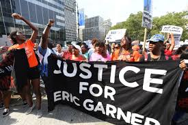 Protesters Carry Coffins, Block NYPD Entrance Demanding Justice for Eric…