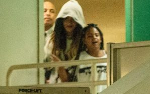 Beyonce hides under a hoodie as she slips out the…