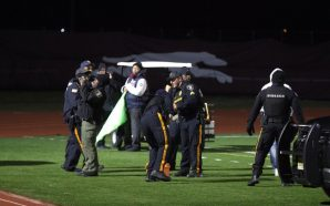 Six charged in high school football game shooting described as…