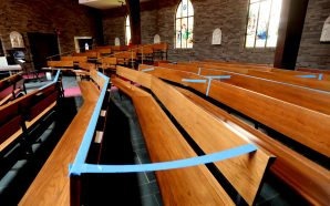 Churches reopen with roped-off pews, masks, singing discouraged